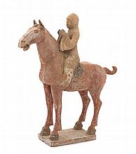 A Polychrome Glazed Pottery Equestrian Figural Group Height 16 inches.