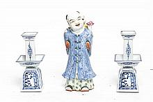 * A Chinese Porcelain Figure, Height of tallest 11 inches.