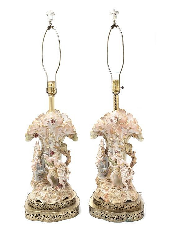 * A Pair of Bisque Porcelain Figural Lamps, Height 34 3/4 inches.
