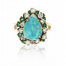 * An 18 Karat Yellow Gold, Opal Doublet, Diamond, and Emerald Ring, La Triomphe, 7.60 dwts.