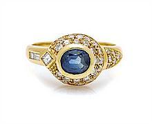 An 18 Karat Yellow Gold, Sapphire and Diamond Ring, 3.40 dwts.