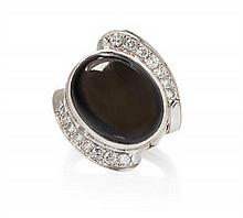 * A White Gold, Black Star Sapphire and Diamond Ring, 7.45 dwts.