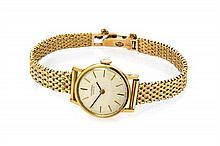 A 14 Karat Yellow Gold Wristwatch, Universal Geneve, 15.80 dwts.