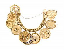 * A 14 Karat Charm Bracelet with Ten Attached Charms, 151.00 dwts.