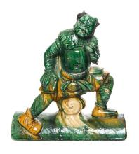 * A Sancai Glazed Pottery Figural Roof Tile Height 12 inches.