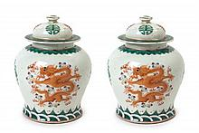 A Pair of Famille Verte Porcelain Jars and Covers Height of pair 8 1/4 inches.