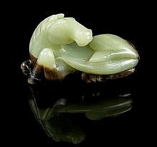 * A Carved Jade Figure of a Horse Width 4 1/2 inches.