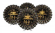 Four Gilt and Black Lacquer Dishes Diameter of each 6 3/8 inches.
