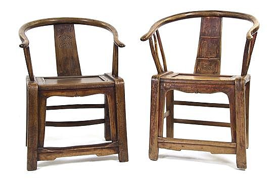 A Near Pair of Chinese Softwood Yokeback Armchairs, Height of tallest 33 1/4 inches.