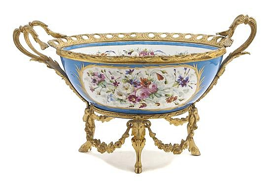 *A Sevres Style Gilt Bronze Mounted Center Bowl, Width over handles 21 3/4 inches.