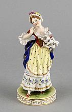 Dame mit Hund, Potschappel, Dresden, 20. Jh., Frau mit Haube und einem Hündchen auf dem Arm, auf rundem Sockel, polychrom staffiert, H. 17 cm