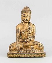 Sitzender Buddha, Asien, Holz geschnitzt, partiell vergoldet, mit kl. Spiegeln und Fabrsteinbesatz, H. 23 cm