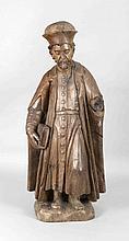 Sakraler Holzbildhauer d. 18. Jh., Heiligenfigur mit Attribut Buch, massive Holzfigur, linker Unterarm fehlend, H. 82 cm