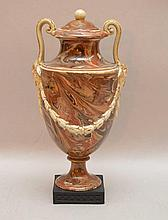 Wedgwood & Bentley Variegated Agate Vase And Cover with foliate molded and gilded handles and mounted atop a square basalt plinth with impressed mark. Condition: we believe the handles have been professionally repaired as the slightly illuminate