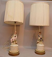 Pair of bisque figural porcelain lamps, 28