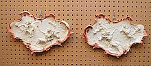 Pair of hanging putti plaques, German mark, 14