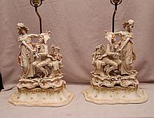 Pair of figural bisque lamps, flowers abound, 29