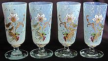 4 Enameled Opaline Crystal Stemmed GobletsEach antique goblet with colorful hand-painted enamel exhibiting a floral and butterfly motif; polished bases; each 6.5