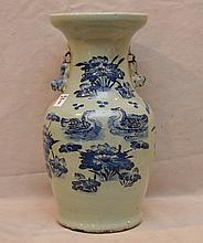 Chinese porcelain vase with foo dog handles and duck motif around, 13 1/2
