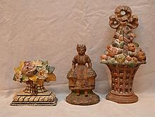 3 antique/vintage doorstops, large fruit basket, girl with flowers and floral basket (with paint loss and rust)