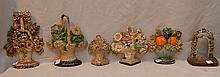 Lot of 6 antique painted doorstops, assorted sizes, floral bouquet motif