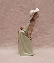 Lladro pretty lady with hands on knee, 8 3/4