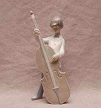 Lladro bow tie boy playing musical instrument