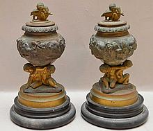 Pair of small bronze covered urns each with 3 putti supports and putti finial, late 19th/early 20th c, 6 1/2