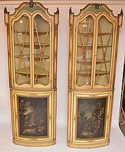 Pair painted Venetian corner cupboards, each with single cabinet doors painted in baroque landscape, tops painted and decorated, shaped interior shelves, 96