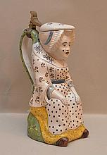 Figural female ceramic/pottery tankard, 10
