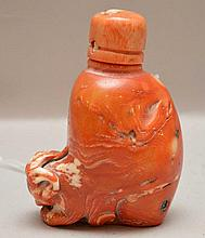 Antique Chinese Coral Snuff Bottle.  Condition: good with minor normal wear.  Ht. 3 1/4
