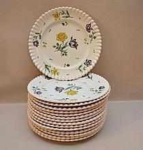 14 floral plates (10 1/2