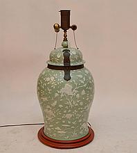 Chinese oversized celadon color lamp with pate sur pate motif, metal strapping