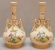 Pair Royal Worcester Porcelain Vases each with hand painted bird scenes.  Condition: minor normal wear.  Ht. 10