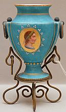 Continental Porcelain Vase mounted in a gilt metal stand. Condition: fading and wear to gilding.  Ht. 7