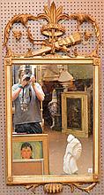 Giltwood trophy motif style mirror, 54