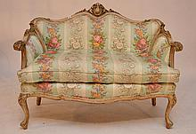 Baroque style carved love seat, quilted floral upholstery