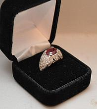 Ladies ring, ruby 7x9mm; total diamond weight 1.5, 14kt white gold