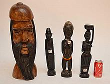 4 wood carvings, 1 Jamaican head and 3 African figures