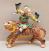 Oriental ceramic Ferocious looking warrior atop tiger, 13 1/2