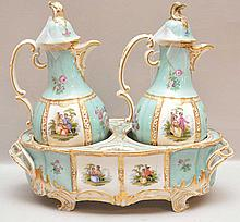 Pair of German porcelain cruets in fitted stands