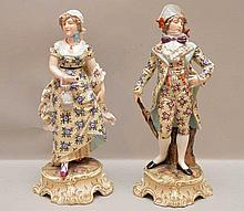 Pair of German porcelain elegant figures with chintz style, polychrome design clothing, 10 1/4