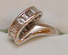 18kt white gold band, .55 baguette diamonds, size 7