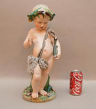 Large 19th Century Samson Porcelain Figure of a child holding a fish.  Condition: some losses to flowers around the base.  Ht. 17 3/4