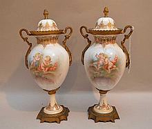 Antique French Bronze & Porcelain Urns each with two hand painted scenes.  Condition: good with minor normal wear.  Ht. 12