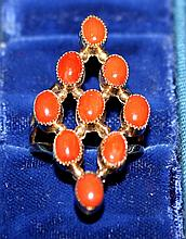 Ladies ring, 14kt gold coral colored stones, 3.6dwt