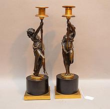 Pair 19th Century Figural Bronze Candlesticks.  Condition: good with minor normal wear.  Ht. 15