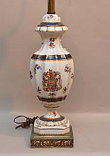 Porcelain urn shape lamp, crest on front