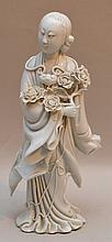 Chinese Blanc De Chine Porcelain Figure.  Condition: the piece has losses to the fingers and flowers.  Ht. 9 1/2