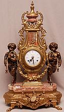 Ornate gilt bronze shelf clock with figural nymphs holding garland on base with claw feet, 25